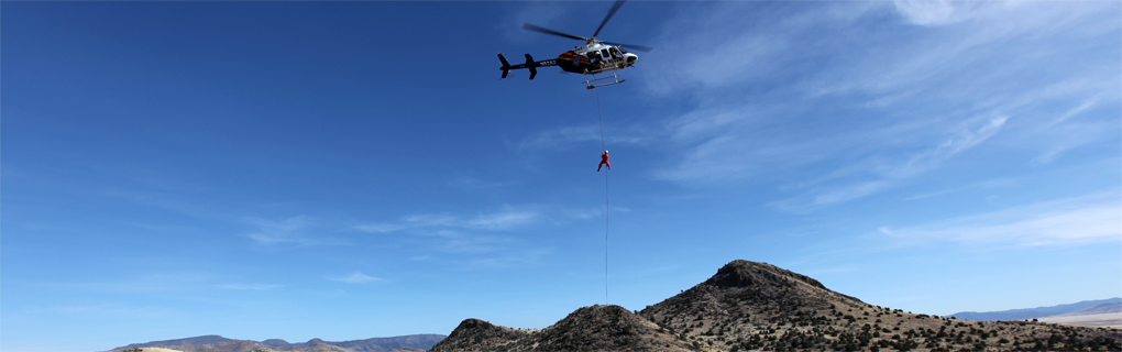 Backcountry Unit hanging from a helicopter